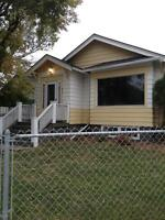 Beautiful 2 bedroom character home with fireplace and garage