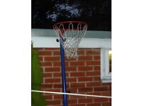 Basketball hoop and pole.