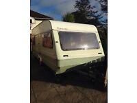 4/5 berth towing caravan . 1994 good condition . Has a cooker and fridge ,
