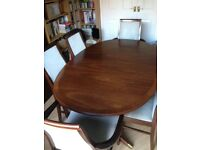 Classic mahogany G plan extendable oval dining table, 6 chairs, and display cabinet.