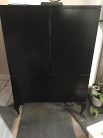 Black unit with shelf in the middle and two drawers