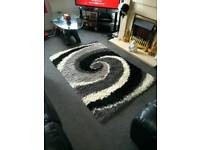 Black grey and white rug