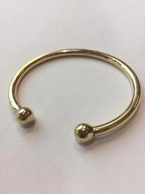 Gold torque bracelet
