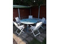 Lovely Wooden Garden Circular Table and five fold away chairs