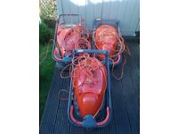 three large flymo hover mowers