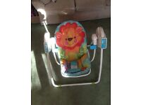 BABY MUSICAL ROCKING CHAIR IN GOOD CLEAN CONDITION.