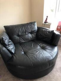 Black leather swivel/tub chair