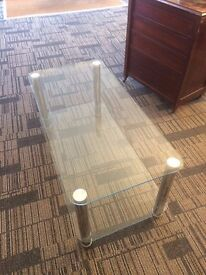 Table glass topped.