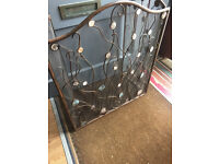 Three fold Fire Screen , with faux mother-of -pearl disks . Must be seen . Size L 50in H 31in.