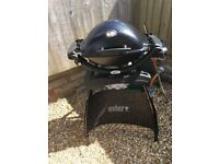 Weber Q-1200 portable BBQ and stand.