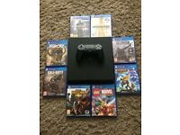 PS4 SLIM WITH 8 GAMES
