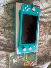 Nintendo Switch Lite + Luigi Mansion 3