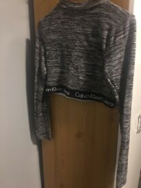 Brand new Calvin Klein high waist long sleeves logo top