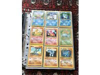 Pokemon cards (Base, Jungle & Fossil sets in folder with doubles)
