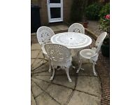 White wrought iron table and chairs set