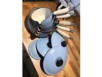 Set of 5 blue cast iron LeCreuset Saucepans with lids
