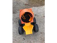 A pedal tractor mixer attachment