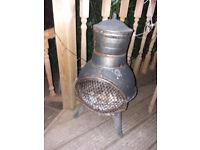 Bronze metal chimenea, good condition. Tonged fork included.ty heavy.