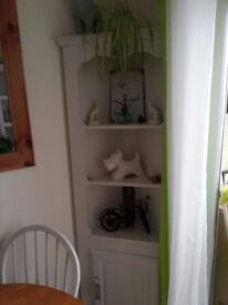 Corner pine ornate unit with shelves and storage cupboard painted white