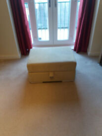 Light green fabric footstool with storage
