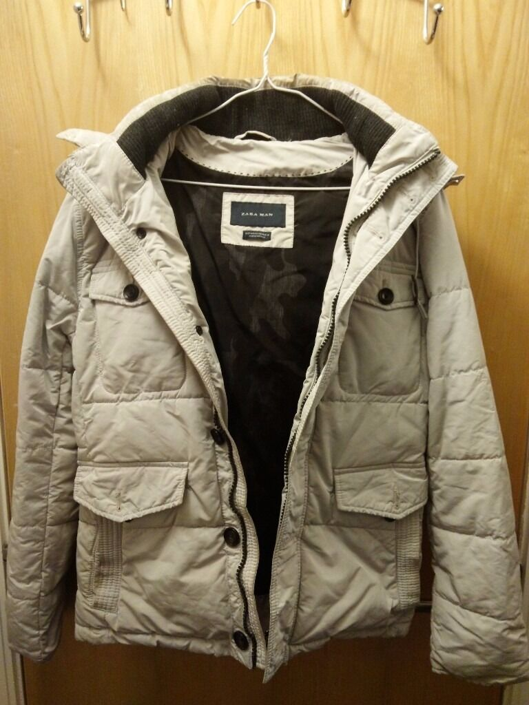 Zara Man original Winter Jacket with detachable Hoodie (Light Greyin Clifton, BristolGumtree - Originally bought from Zara store in Cabot Circus. Size Eur M/USA M/MEX 40. All buttons and zips work fine. Condition used & slightly stained(not permanent). There are no tears, damages or ripped parts. Available for testing before buying(not to be...