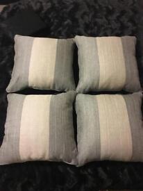 4 grey cushions