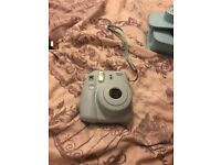 Fujifilm Polaroid camera in good condition and hardly ever been used