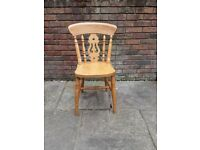 3ft round pine table and three chairs,one is a carver excelent condition £120
