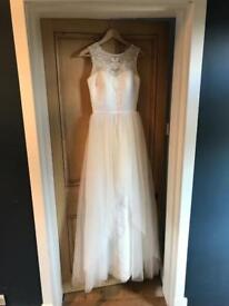 Size 8 never worn wedding dress