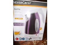 Electric Kettle Cordless,stainless steel with purple finish.Brand new and boxed.