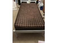 single wooden bed with matress.