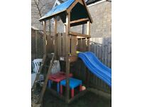 Wooden climbing tower frame with wavy slide