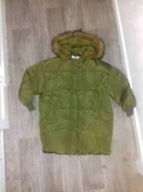 Oversized green parker fur hood