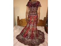 Red lengha with jewellery and bouquet