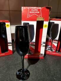 8 x Black lustre wine and 8 x champagne glasses. Perfect condition.