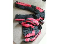 Motorcycle jacket trousers and gloves.