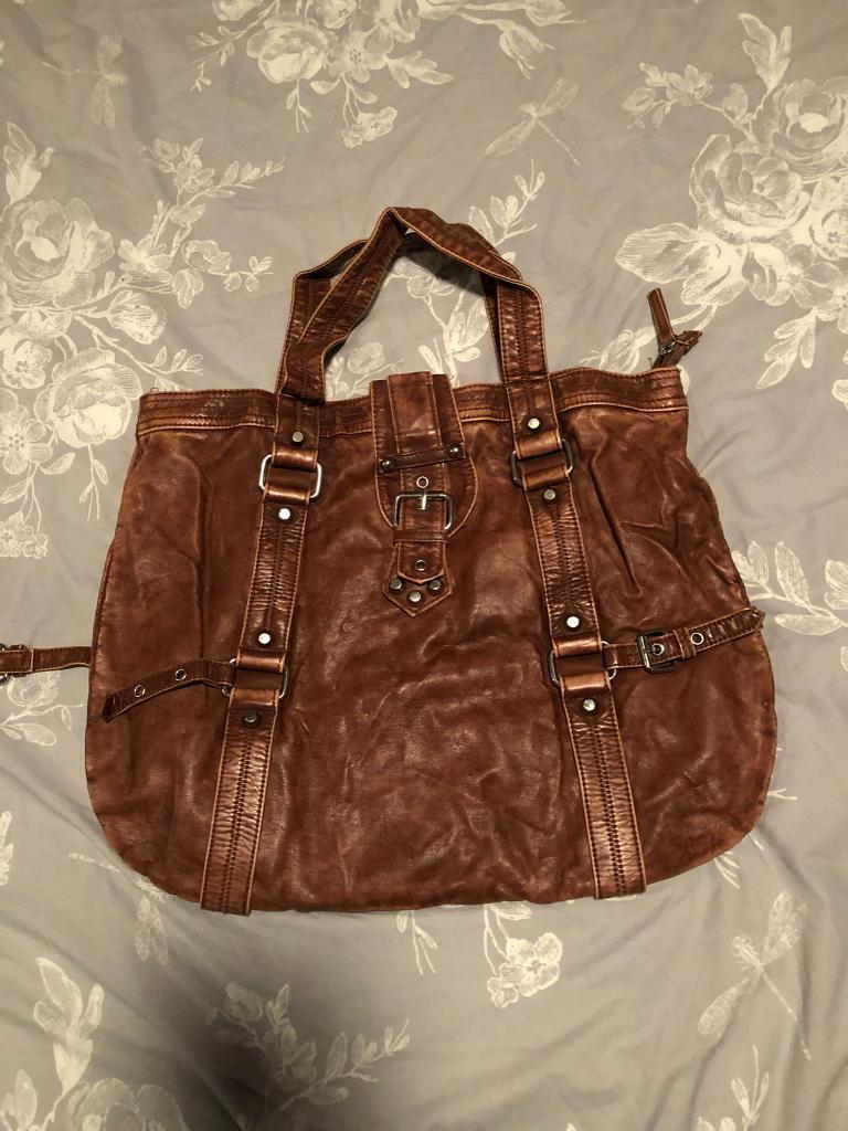 Brown River island distressed leather bag