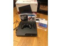 PlayStation 3 console with controller, headset, 2 games and controller charger