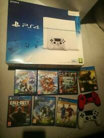 PS4 WHITE BOXED WITH LOTS OF GAMES