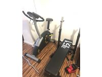 Exercise bike and bench, both good condition and working
