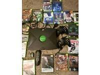 Xbox console with games