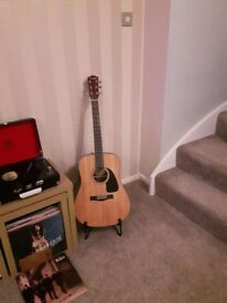 Fender acoustic guitar with stand