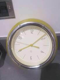 HABITAT Delia Yellow metal wall clock. Mint condition almost new. Very stylish clock.