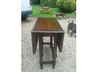 antique gate leg barley twist table.