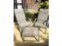 Pair of garden chairs with foot stools