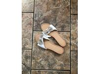 Gold and white flat mule with bow
