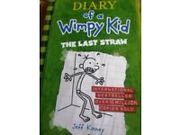 Four books from the Diary of a Wimpy Kid series.