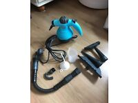 Brand new hand held steam cleaner with attachments