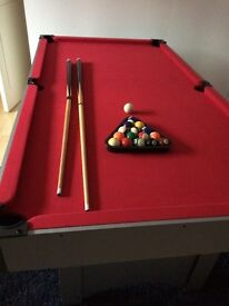 6ft DEBUT pool table. Unusual red felt. Includes balls triangle and 2 que's. Good condition.