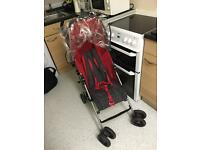 Mamas and papas red swirl pushchair